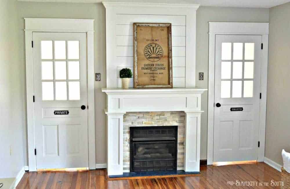 Beautiful fireplace surround with ledge stone tile and shiplap. Such an easy way to do a DIY farmhouse style fireplace makeover on a budget with shiplap above the mantle and using stone tile and ply wood