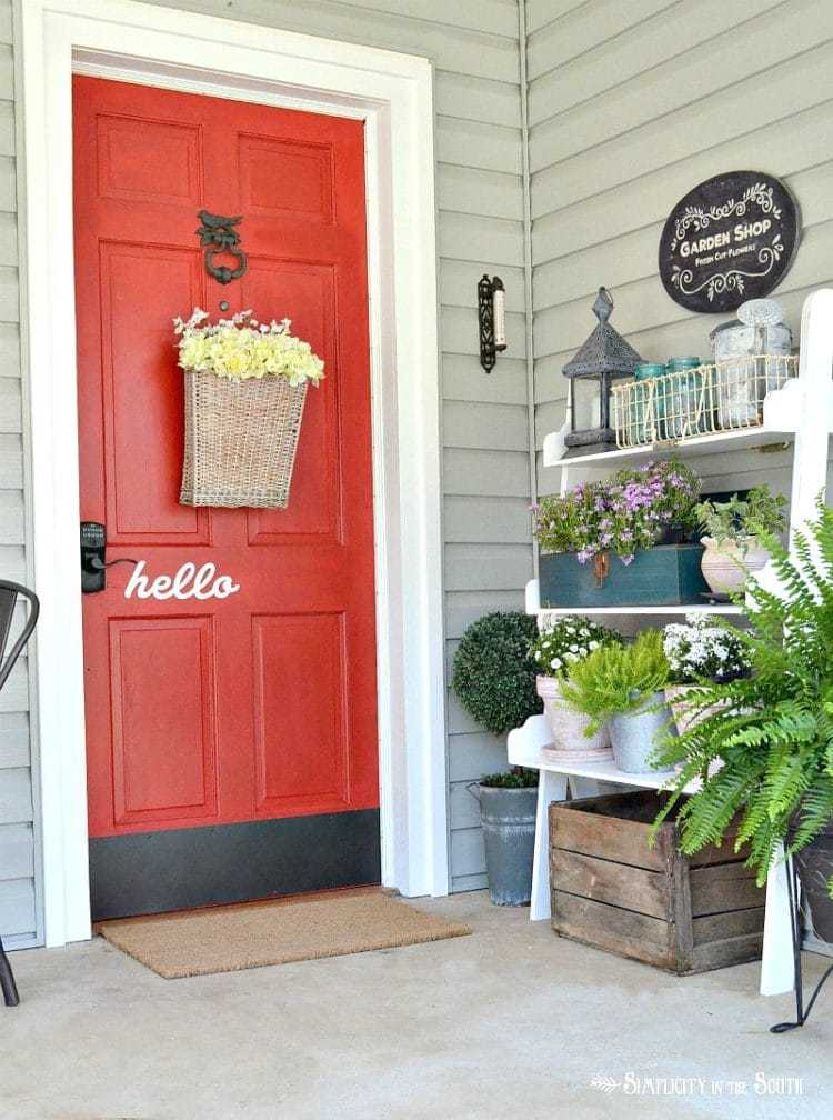 Spring Home Tour 2017- Front porch with red door painted in Sherwin Williams Real Red SW 6868