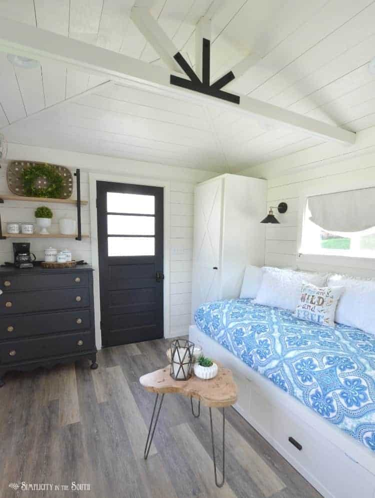 A garden shed is transformed into a cottage guest house on a budget