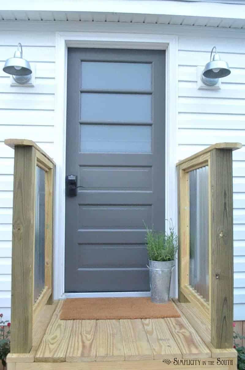 Galvanized farmhouse style lights and galvanized metal porch railing