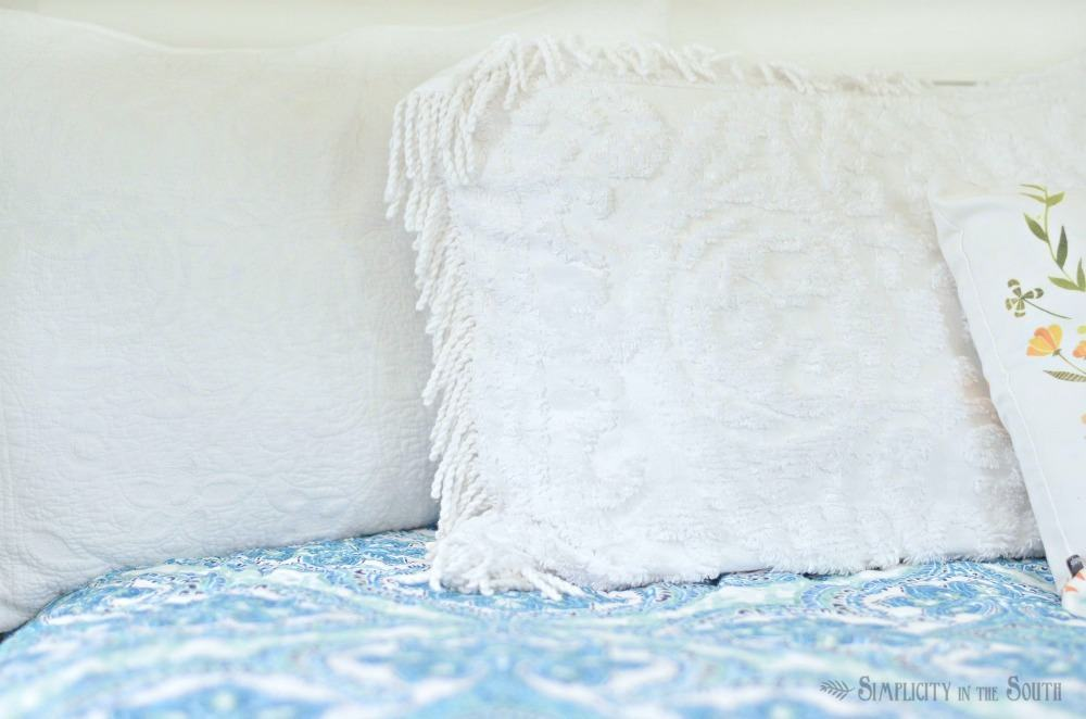 chenille fringed shams and blue medallion quilt.