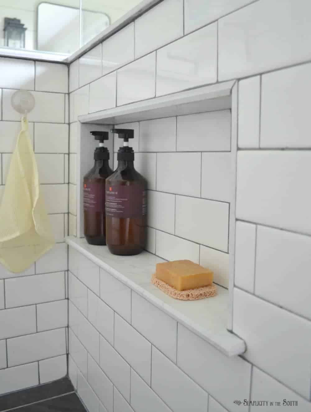 Add a hidden cubby in the shower for soap and shampoo. This is a good way to add storage in a bathroom and make it look neat and organized.