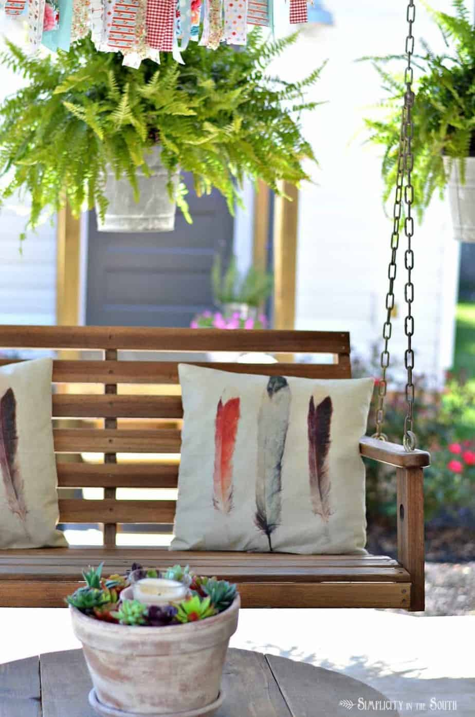 Front porch swing and hanging ferns