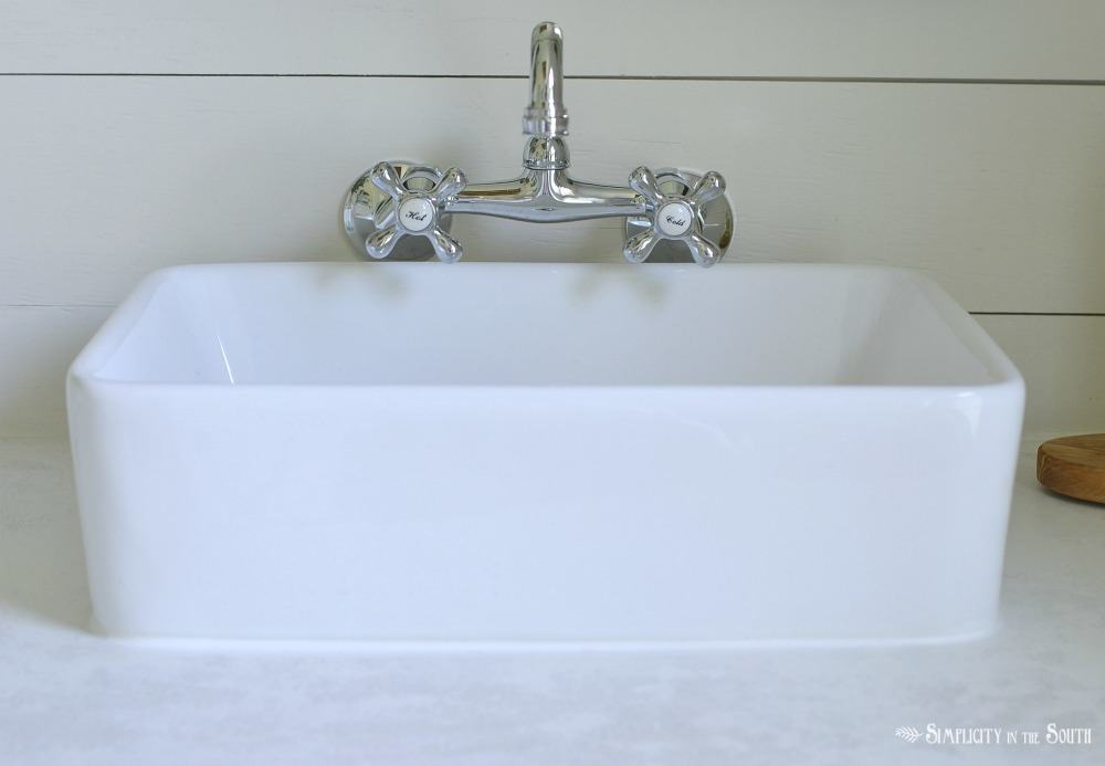 Placement of wall mount faucets over the vessel sink in the bathroom