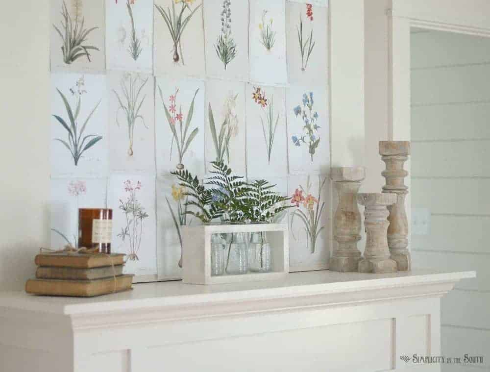 Summer decor for your fireplace mantle can be as simple as using free botanical printables, vases filled with fern leaves, and candle holders.