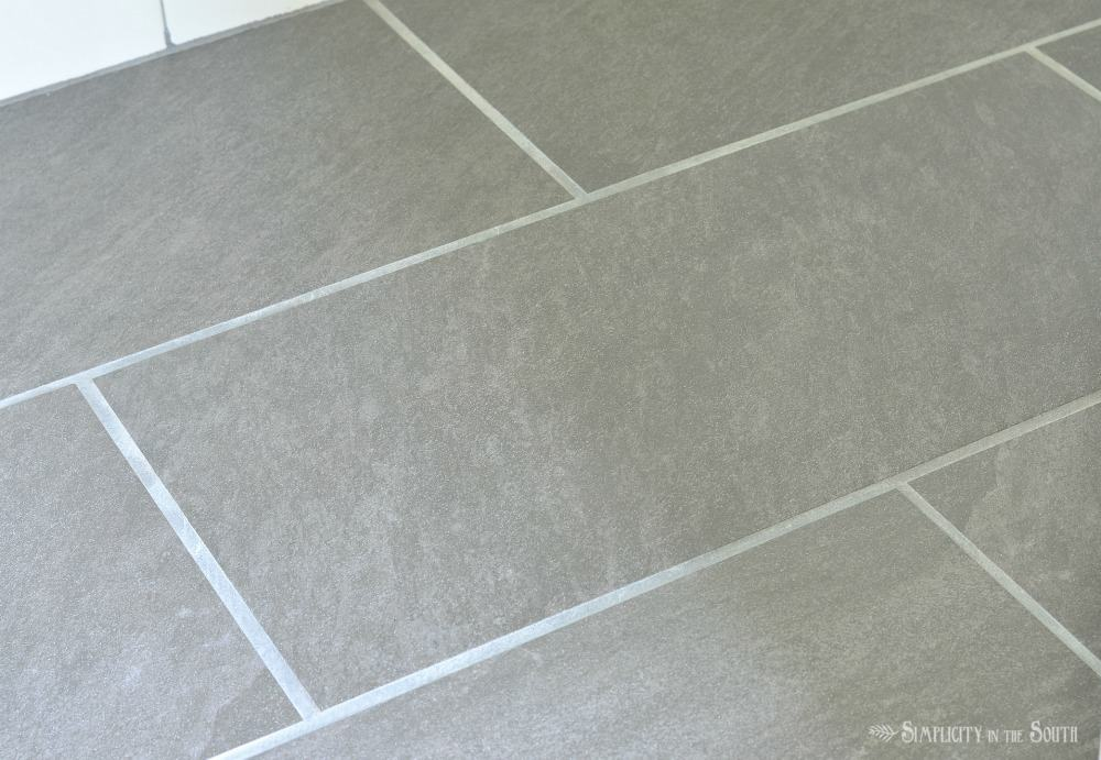 Tile floor in the bathroom that looks like slate but it's porcelain. It can be used in the shower but never needs sealing and has enough texture to keep you from slipping.