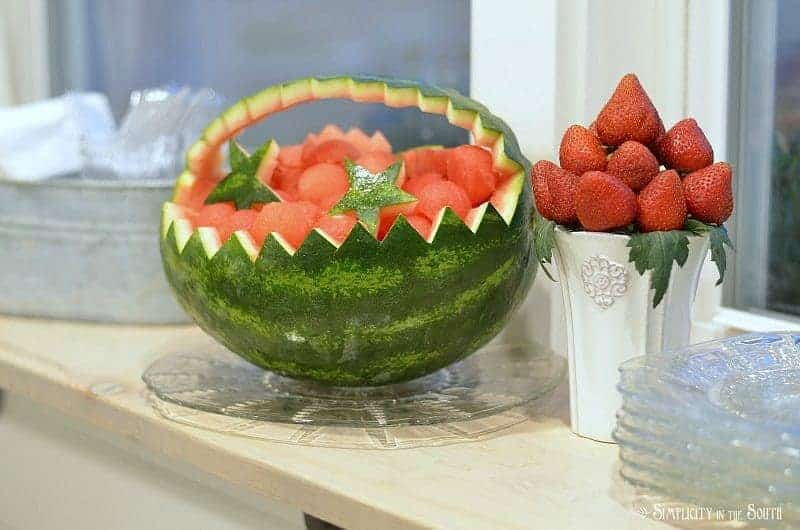 Carved watermelon basket and strawberry bouquet