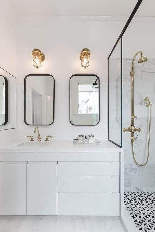 black and white bathroom with rounded rectangle mirrors via Geddes Ulinskas Architects