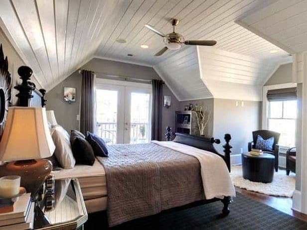 Attic bedroom with planked ceilings and medium gray paint