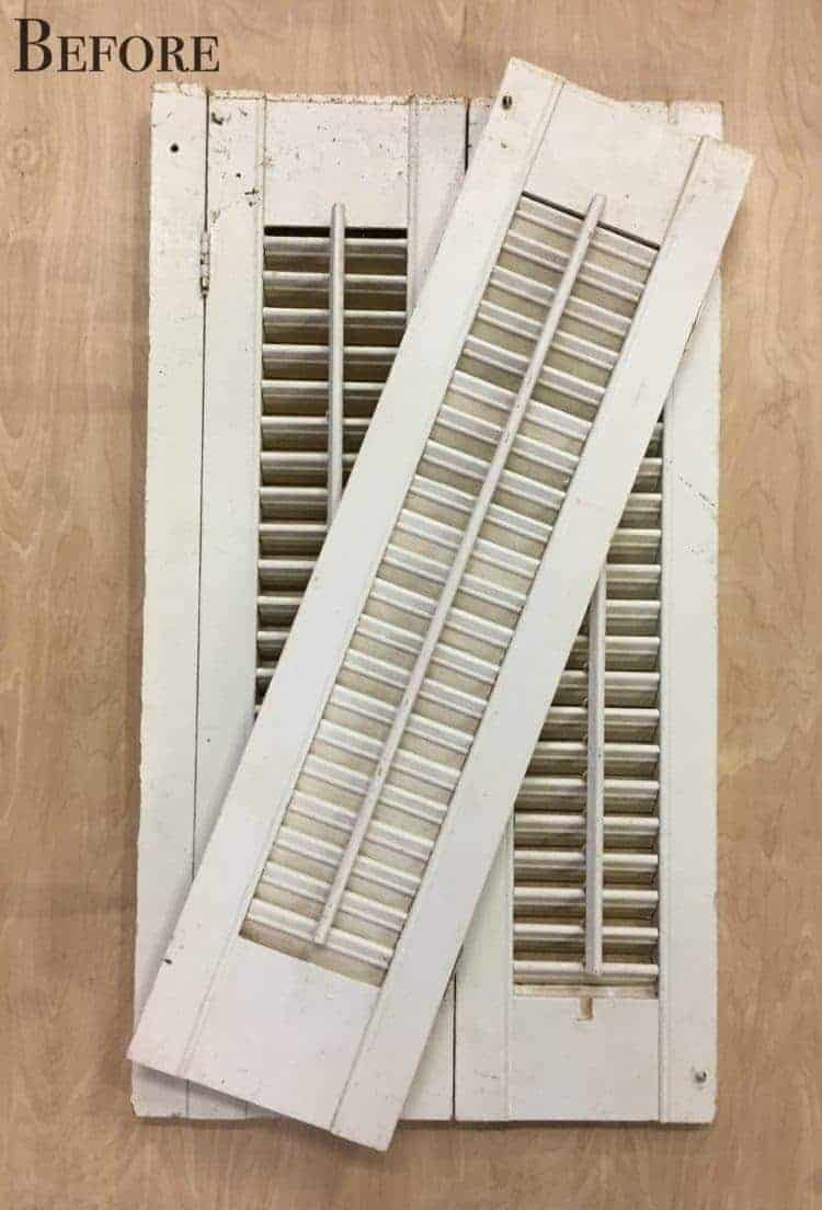 Need some over the toilet storage ideas? In this DIY project, shutters were repurposed into a farmhouse style shelf for the bathroom. This is one of my favorite Ballard Designs knock offs!