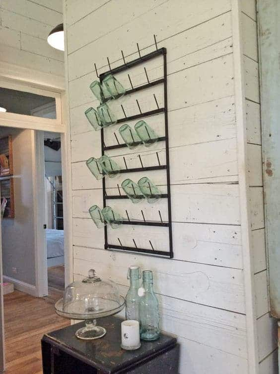 Fixer Upper Magnolia Homes Kitchen with shiplap walls and glassrack beside the island