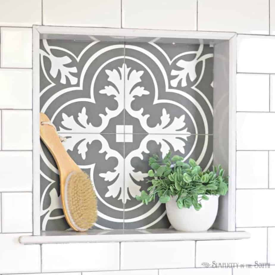 black and white tile inset shower cubby - Merola Twenties tile from Home Depot