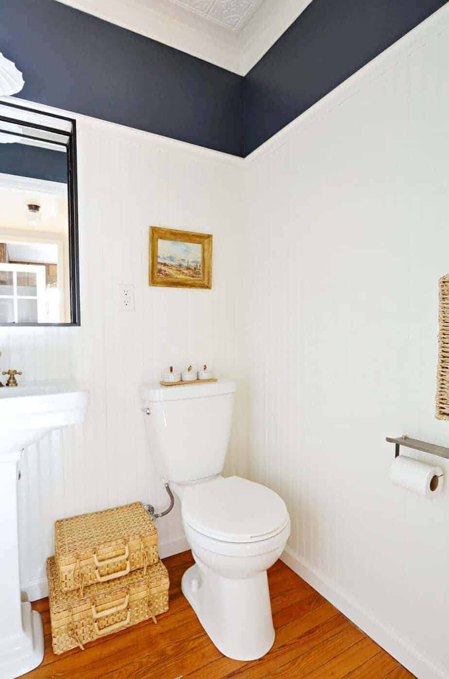 modern vintage navy and white powder room