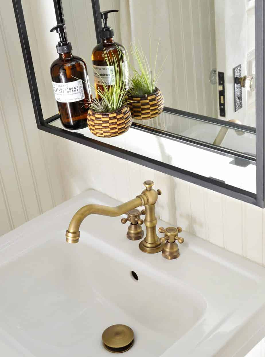 pedestal sink with widespread antique brass faucet