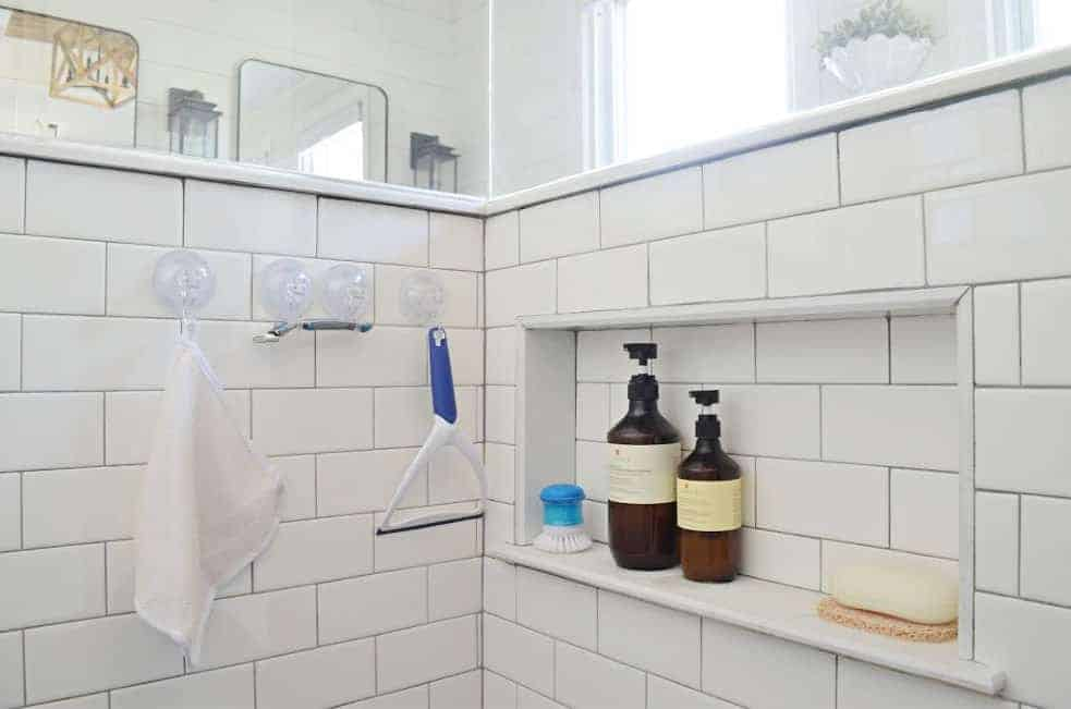 shower cubby in pony wall to organize shampoo and soap in the bathroom