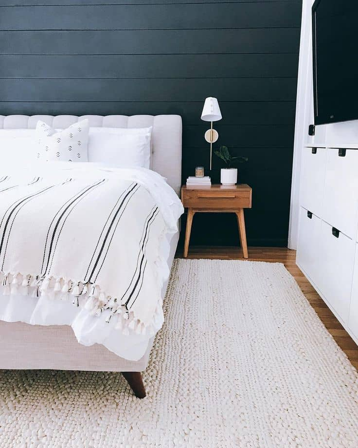 bedroom design idea with black shiplap wall from Restoring Home on Instagram