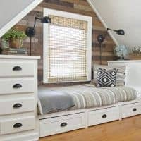 dormer bedroom with built in bed and storage trundle drawers