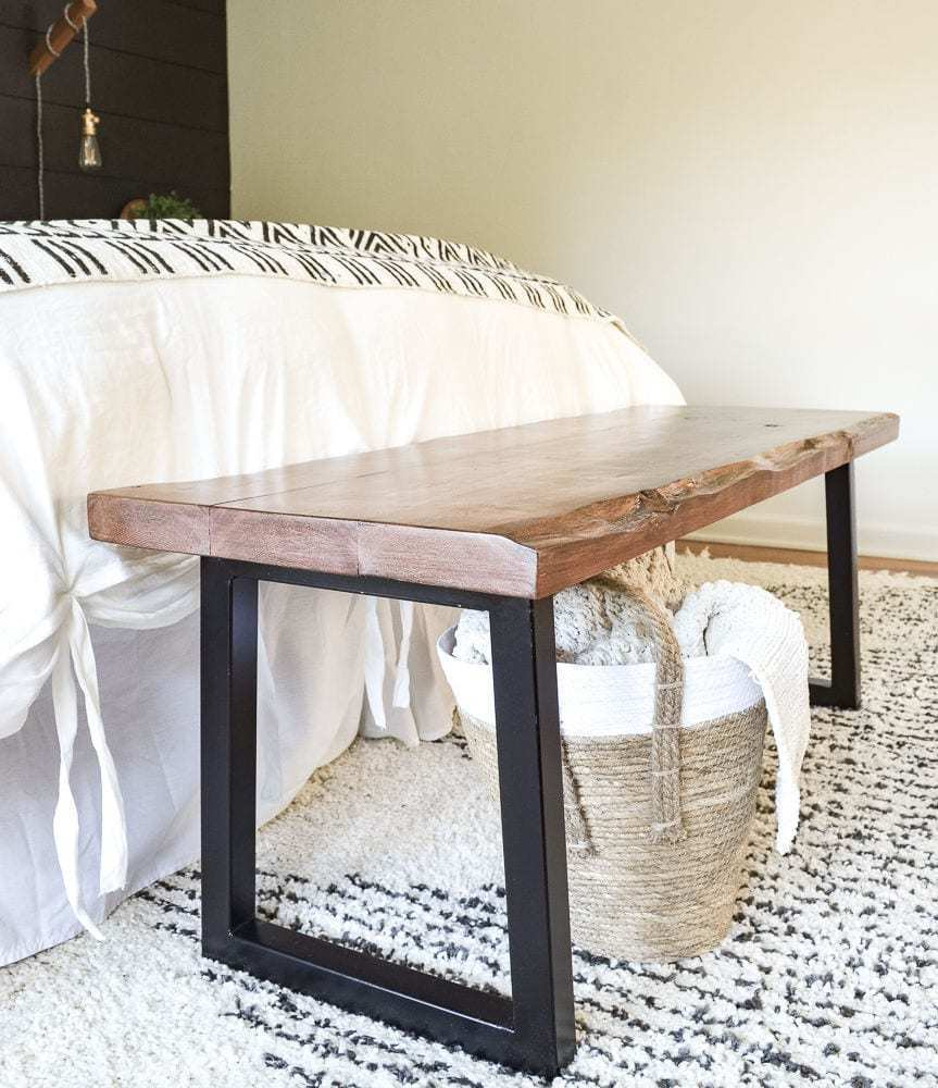 cedar bench at the end of the bed with modern trapezoid welded steel legs