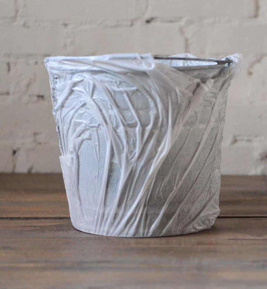how to age galvanized metal pails with Lysol cleaner
