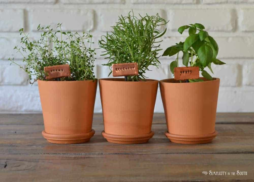 how to make stamped copper metal plant markers for an herb garden