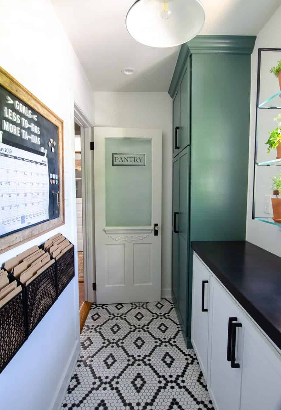 narrow walk in kitchen pantry remodel with hexagon tiled floors cabinets and glass door (1)