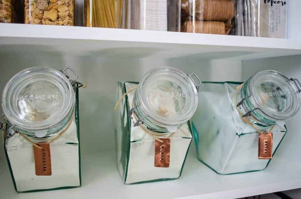vintage glass Hermetic pantry canisters with DIY stamped copper pantry labels