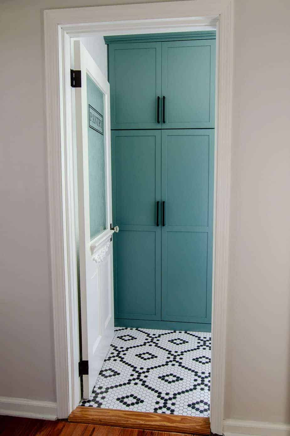 walk in pantry remodel with cabinets and glass pantry door