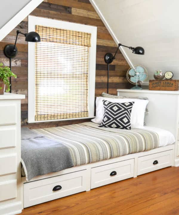 How to Make a Built-in Bed Using Kitchen Cabinets & a Rustic Planked Wall