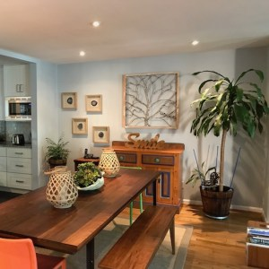 wooden dining room table with plants