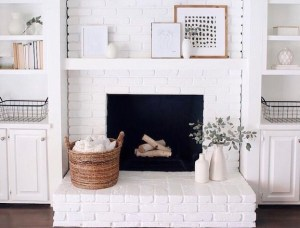 white fireplace painted brick
