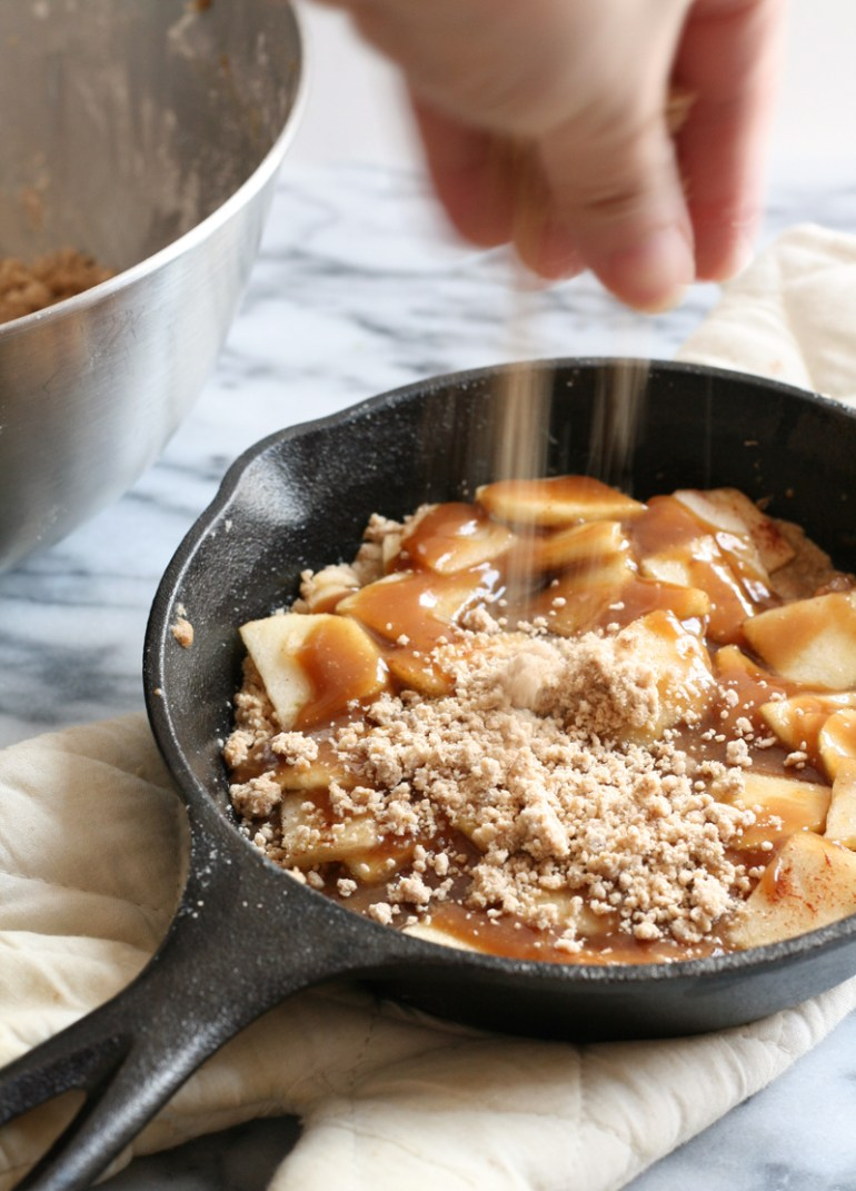 apple crumble with salted caramel sauce baked in skillet