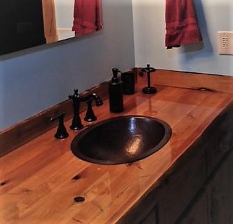 19 oval copper bath sink in wooden countertop