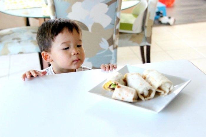 kid looking at burritos