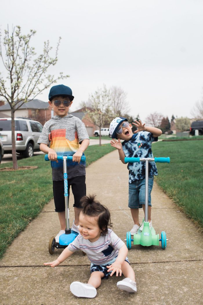 Comfy Stylish Summer Outfits for Boys, boys riding scooters and playing outside