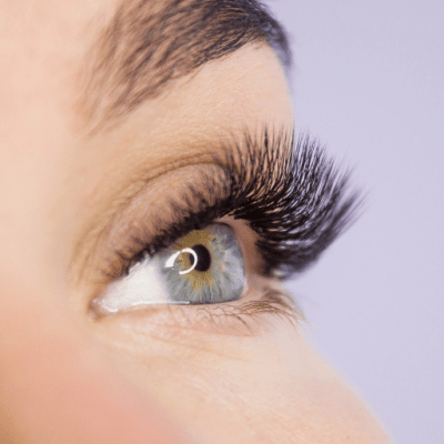 Woman with Artificial Lashes Making Her Eyes Stand Out