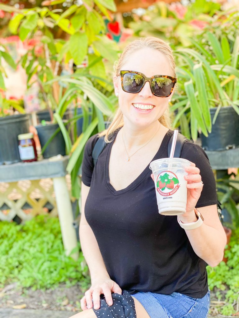 Holley with a strawberry milkshake at parkesdale farms