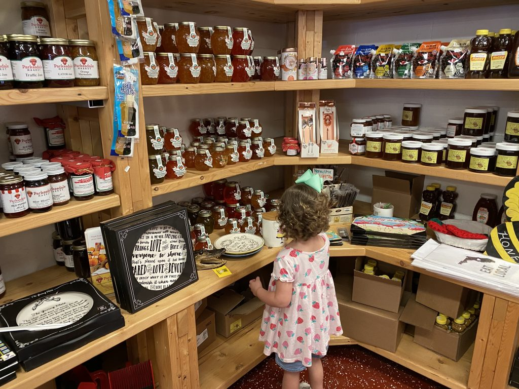 Caroline looking at the jams and jellies to buy at  Parkesdale Market