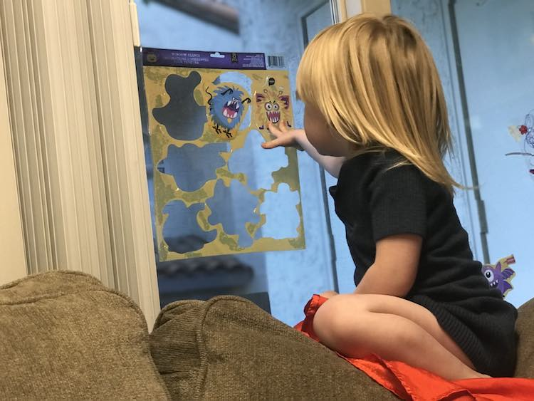 Wanting a picture with her puzzle when she saw me with my phone.