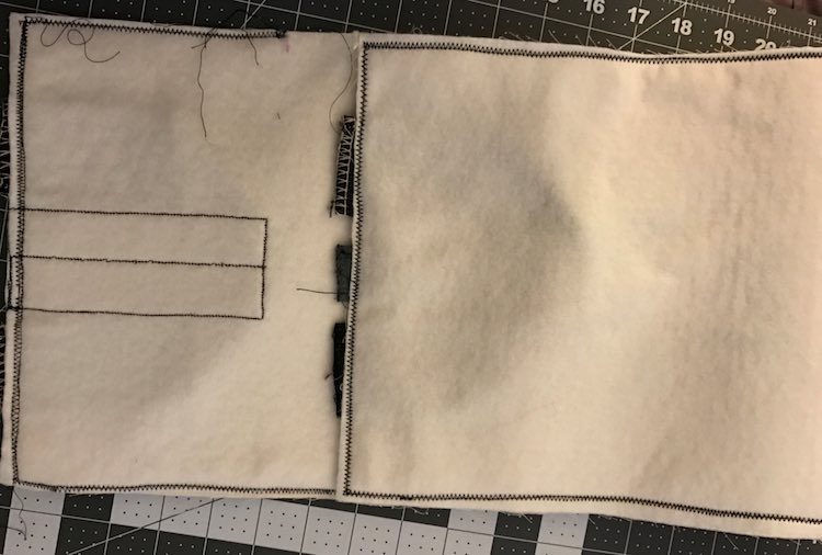 The tips of the handles and closure flap sticking out after being sewn down.