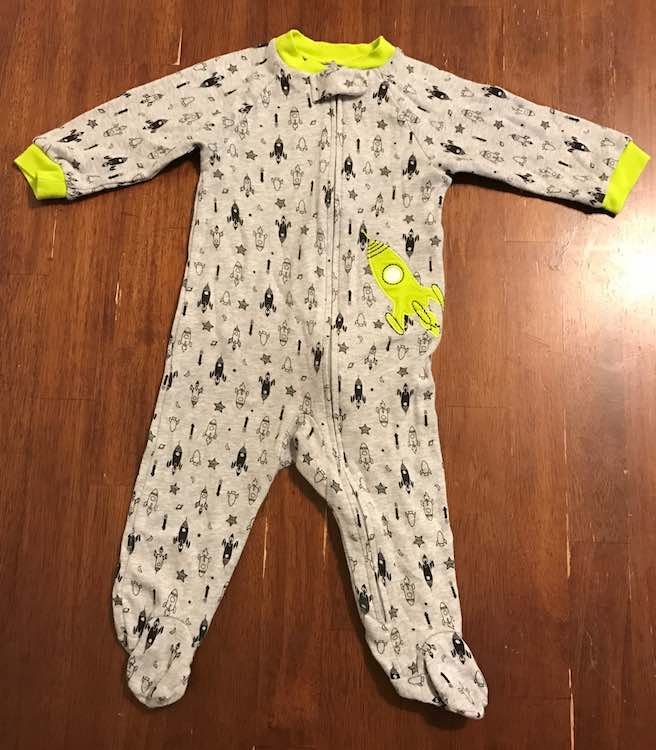 The front of the onesie right after I bought it.