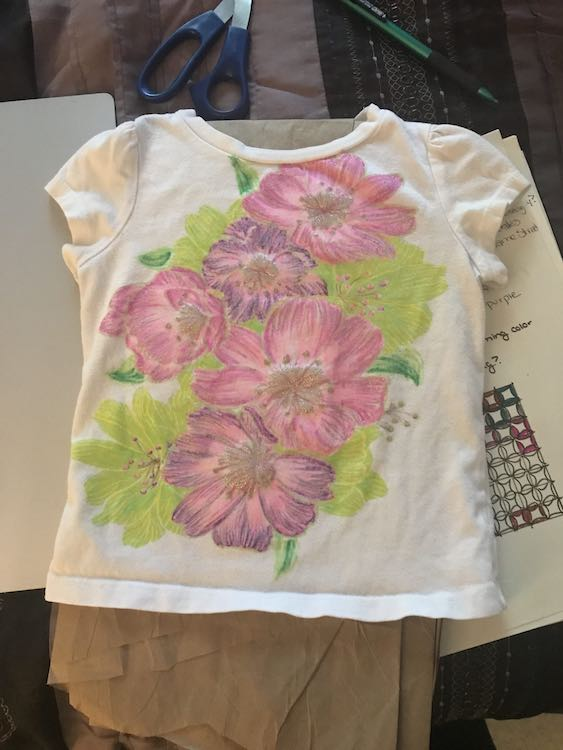 Finished t-shirt. The glitter shows through the colored petals. I had also added details to the leaves.