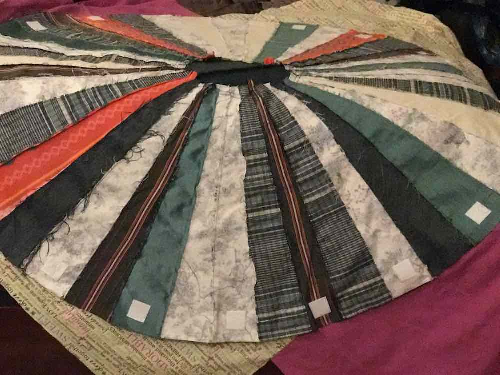 Laying the finished outer layer overtop of the fabric that will become the inner layer.