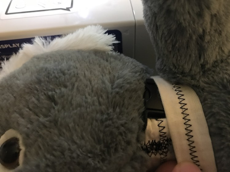 Size the collar by laying it over your stuffed animals neck and sizing it. Remember your stuffed animal will not grow and cannot choke. You need just enough space to be able to do it up and undo it.