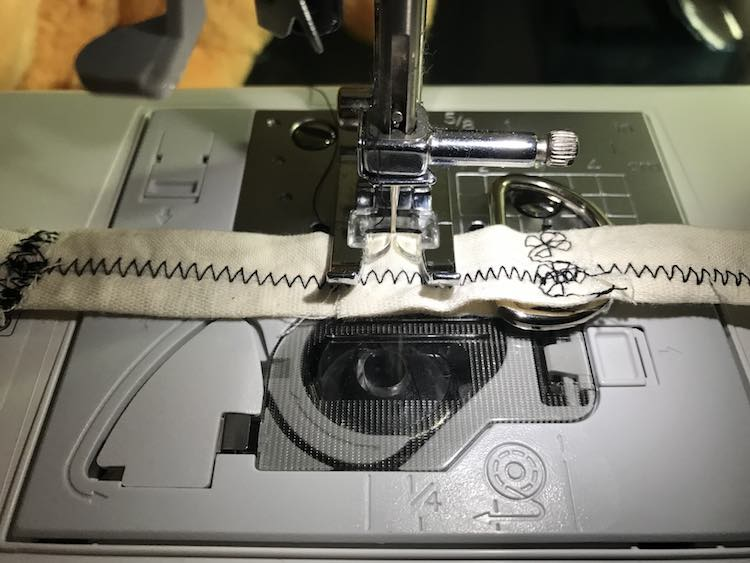 Make sure the D ring is in place before sewing down the other side.