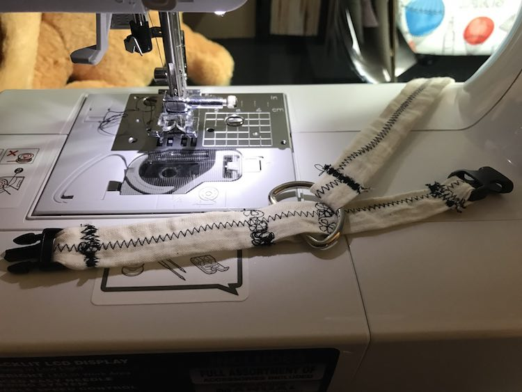 I then brought one end of the leash through the D ring, folded it over, and sewed it on.