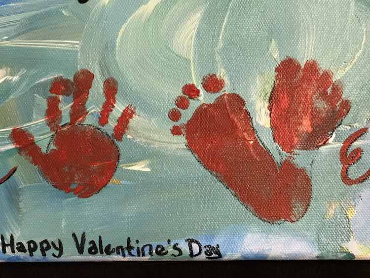 "Add the handprint ""O"" and the two footprints ""V""."