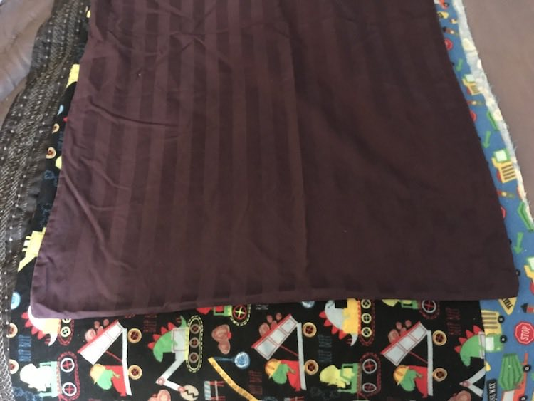 Comparing my folded over fabric to a store bought pillowcase showed that mine was way longer and slightly taller.