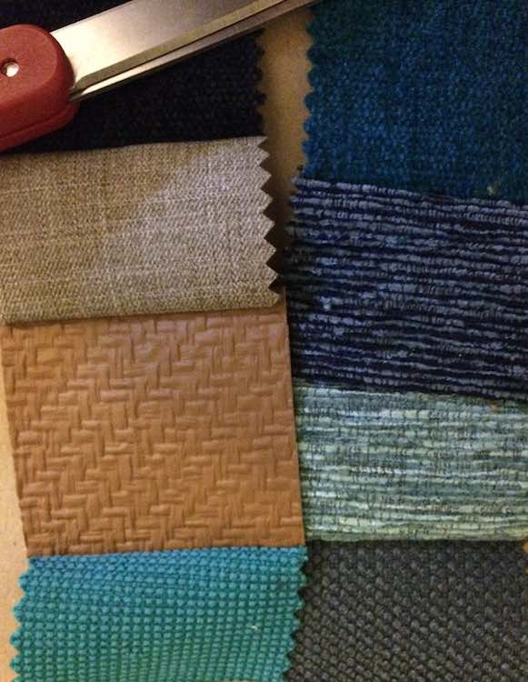 Fabric sample squares sewn into strips.