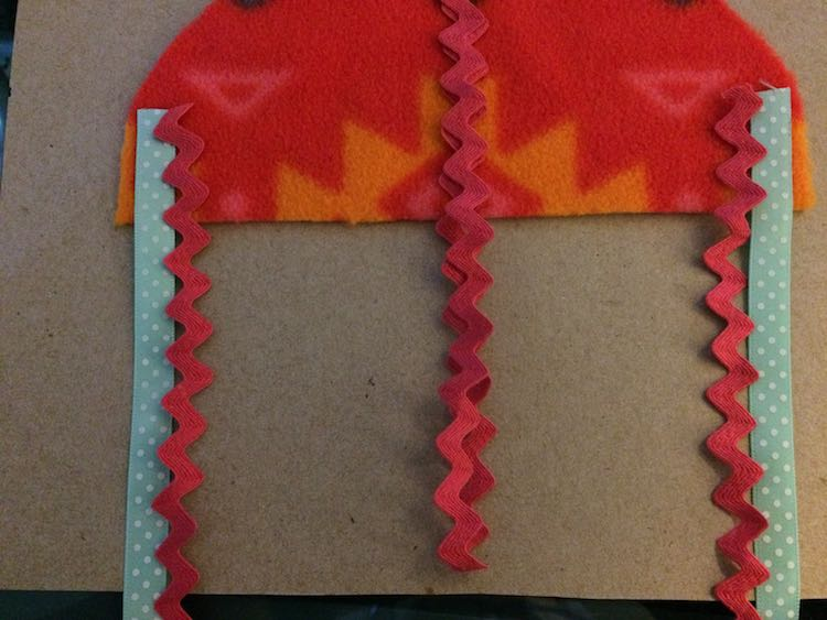 Then added my center and more edge ribbons. As these are folded over (looped) I made it shorter than the page.