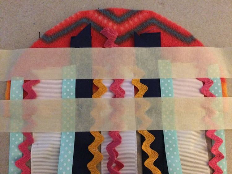 Added masking tape above and below where I was going to sew the ribbons to keep it in place.